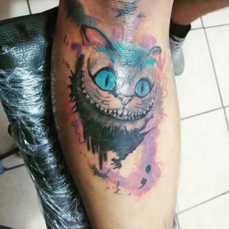 Gato Sonriente  tatuaje realizado por Omar Mendoza