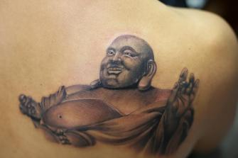 BUDA tatuaje realizado por Old Gangsters Tattoo Shop