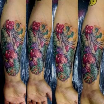 Hiper realismo color  tatuaje realizado por West
