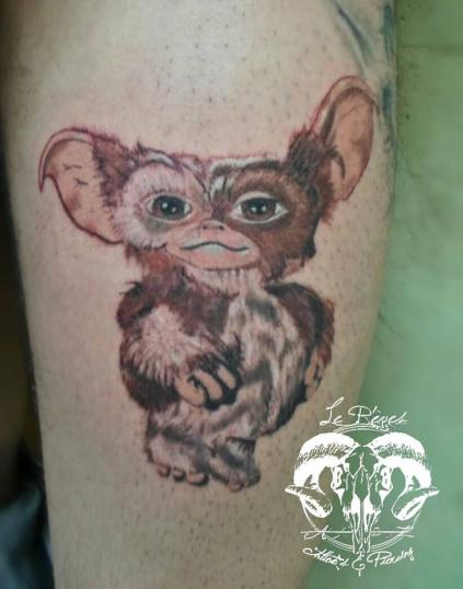 gizmo gremlin tatuaje realizado por Le rêves tattoo`s & piercing
