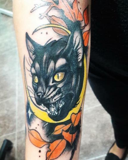 Gato negro tatuaje realizado por Dany R. Salazar