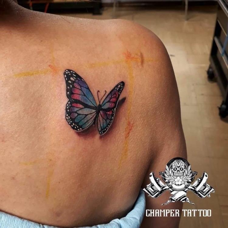 Mariposa en 3d tatuaje realizado por Champer tattoo Querétaro