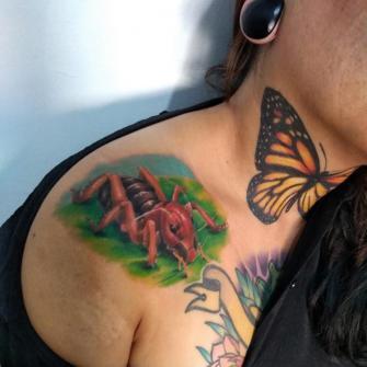 Cara de niño tatuaje realizado por Carlos Koyote Ramirez