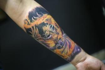 AVE FENIX  tatuaje realizado por Old Gangsters Tattoo Shop