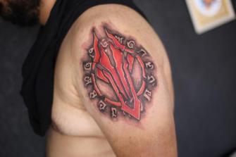 simbolos en la piel tatuaje realizado por Old Gangsters Tattoo Shop